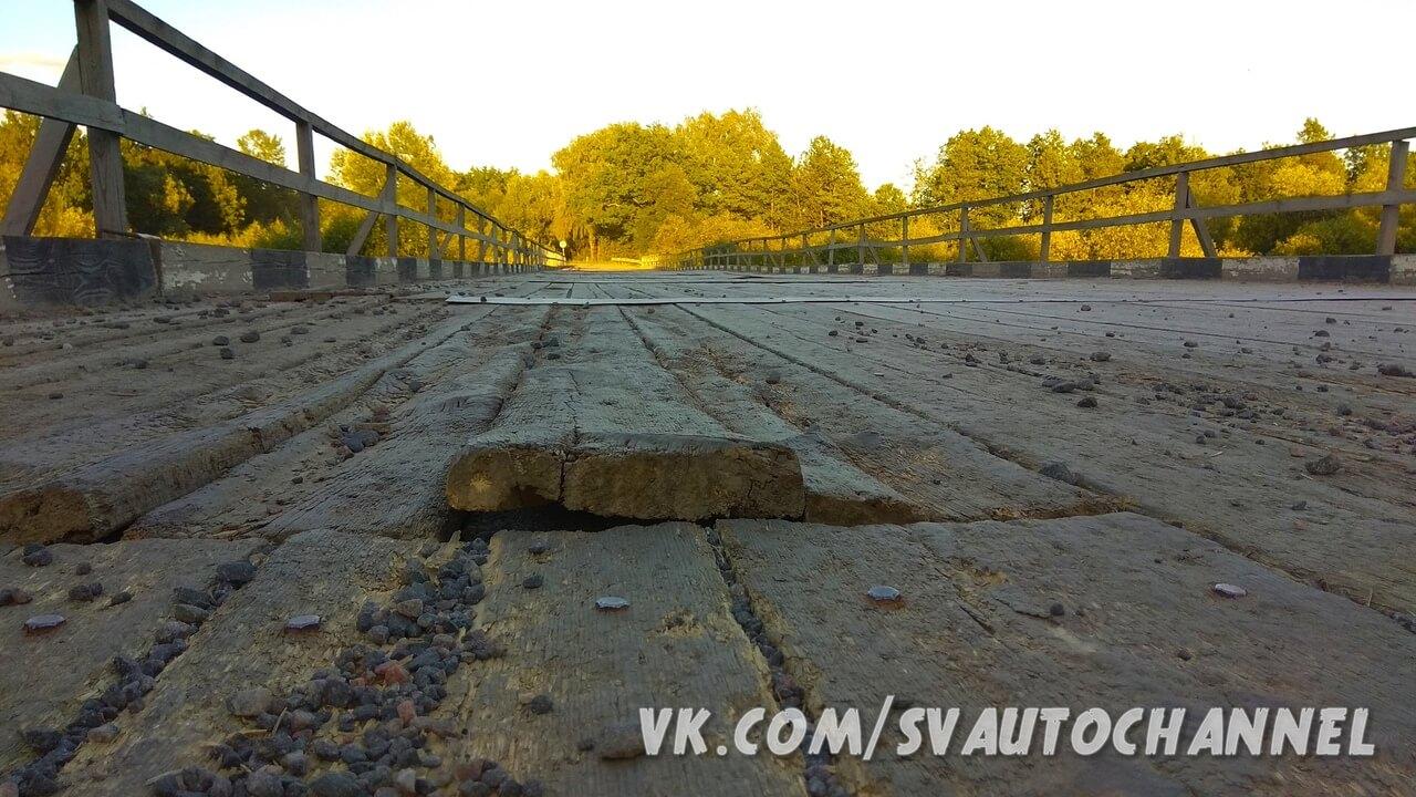 Деревянный мост через реку Птичь покрытие